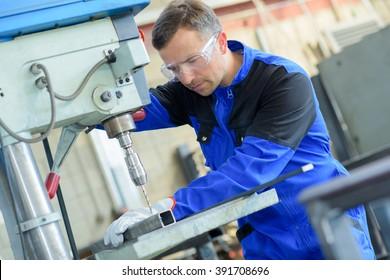 Man drilling through metal