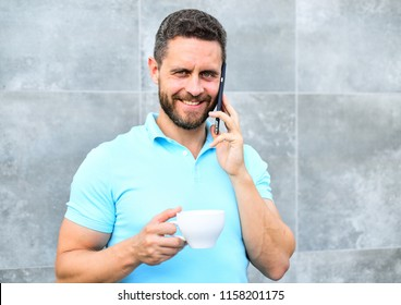 Man drink cappuccino speak phone grey wall background. Reasons entrepreneurs drink coffee. Even if you drink coffee on the go each sip is little break in your day and little moment of self care.