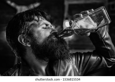 Man drinking alcohol. Whisky, brandy or cognac concept. Serious sad man having alcohol addiction. Alcohol addiction concept