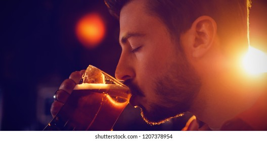 Man drinking beer in bar