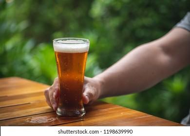 Man drinking beer in the garden