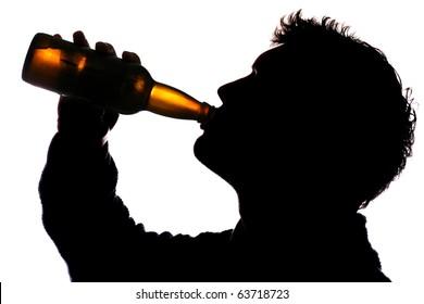 Man drinking bottle of cider silhouette