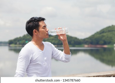 Man Drinking clean Water after jogging