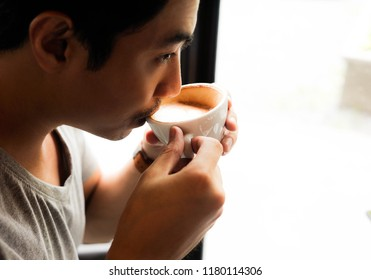 A man drinking coffee,Asian man taste coffee ,Selective focus