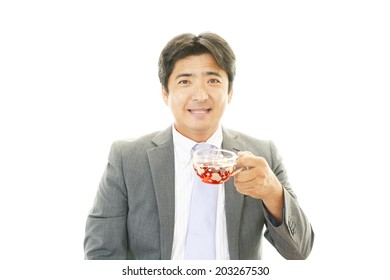 Man drinking cup of tea