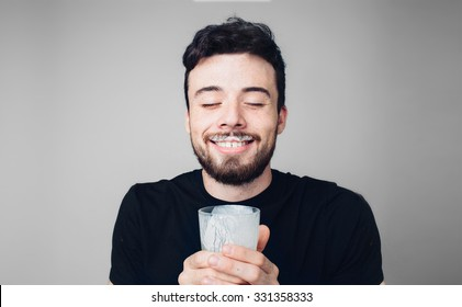 man is drinking fresh glass of milk isoladed on isoladed on light