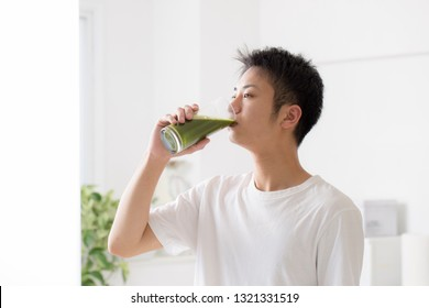 A man drinking green juice for breakfast
