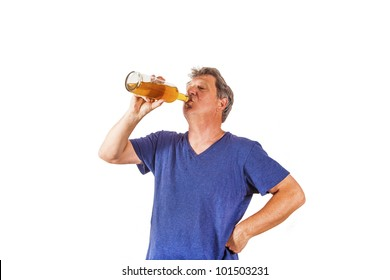 man drinking out of a glass