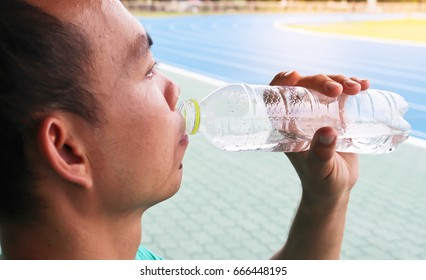 Man drinking water. Healthy concept.
