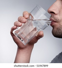 Man drinking water isolated in studio