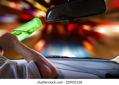 Man drinking while driving.