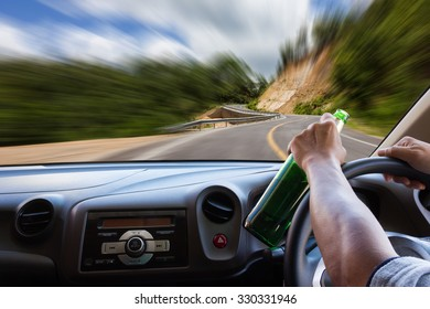 Man drinking while driving .