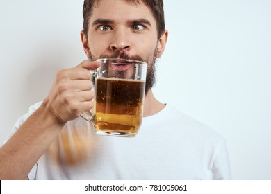 a man drinks beer on a light background, alcoholism