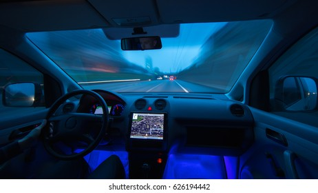 The man drive a car on the evening highway. Inside view. Wide angle