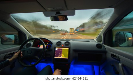 The man drive a vehicle on the highway. Inside view. Wide angle