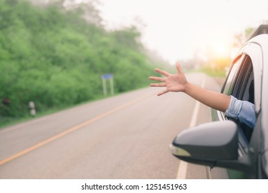 Man driver feeling the wind through his hands while driving in the country side.(freedom concept)copy space.