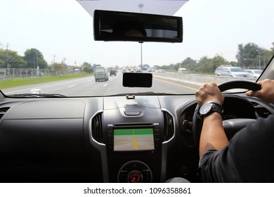 Man driver hands holding the car steering panel