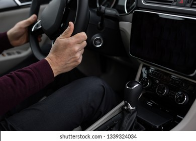 Man drives car, close up of hands holding steering wheel