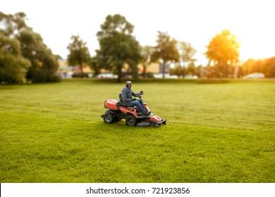 man drives a lawnmower