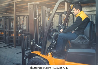 Man drives a reliable heavy truck loader. Heavy duty equipment. Tractor or roller paving vehicle. Reliable heavy loader, forklift truck. Heavy duty equipment background