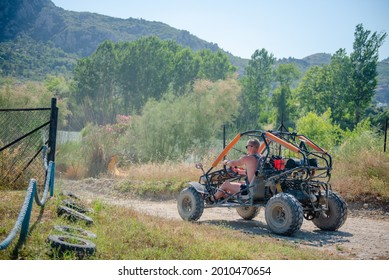 Man driving a buggy car on dusty road during buggy safari tour