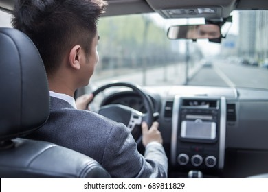 man driving car with navigation system