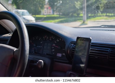 Man driving car on countryside. Inside view.