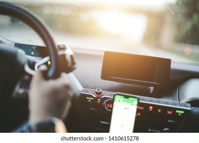 Man is driving the Car on the Street