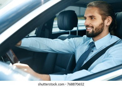 Man Driving Car. Portrait Of Smiling Male Driving Car. Successful Young Business Man Going To Work In Comfortable Auto. High Resolution.