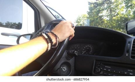 man driving car steering wheel