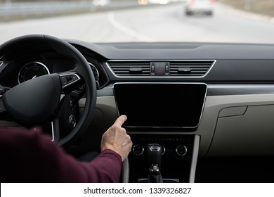 Man driving the car and using navigation, drivers view
