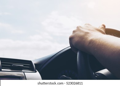 Man driving car using one hand
