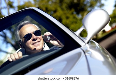 Man driving convertible