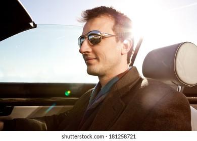 Man driving a convertible car