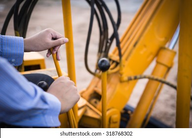 the man driving Excavator or Backhoe