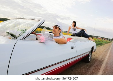 a man driving a happy woman in the background, warm and happy picture