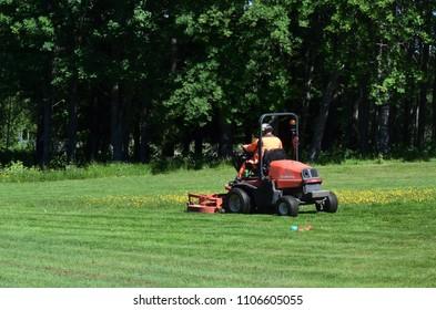Man driving lawn mower - Kubota F3890 machine - Kongsvinger, Norway (6th June 2018)