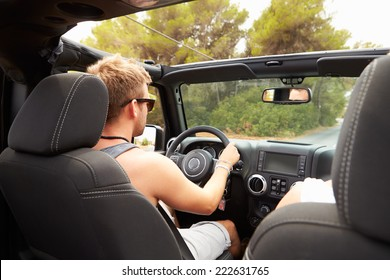 Man Driving Open Top Car Along Country Road