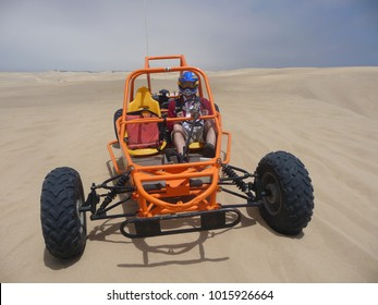 Man driving a sand buggy in Oceano Dunes State Recreational area, California, 2010