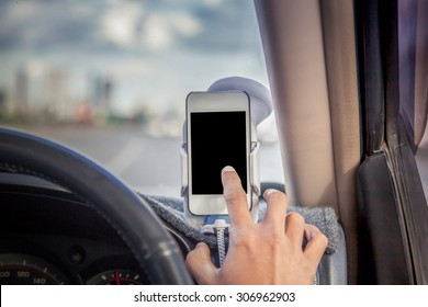 Man driving and using phone,smart phone,tablet,cellphone in car
