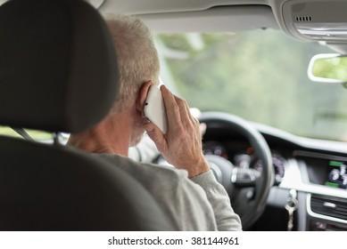 Man driving using smartphone