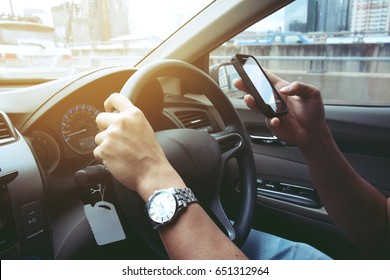 man driving while using telephone