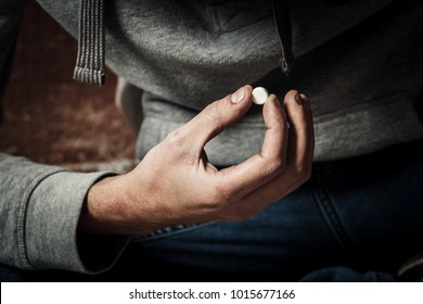 A man is a drug addict using drugs. The concept of anti drugs.