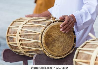 Man drumming in Indian wedding ceremonies, selective focus.