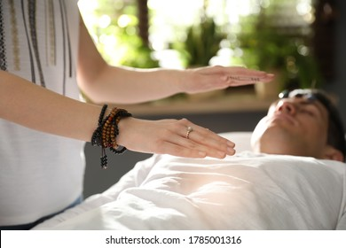 Man during crystal healing session in therapy room