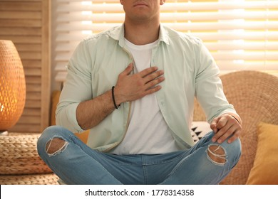 Man during self-healing session in therapy room, closeup