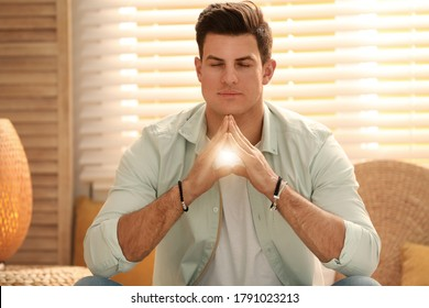 Man during self-healing session in therapy room