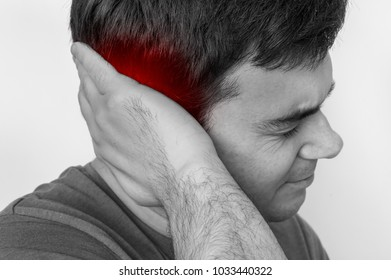 Man with earache is holding his aching ear - black and white photo