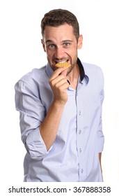 man eating a biskuit