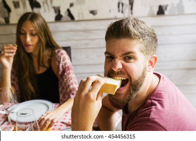 Man eating bread with crazy face